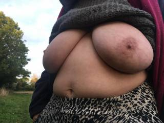 Standing at an angle, on a footpath alongside a field today - hands in pockets, jumper pulled up, tits out