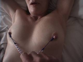 Pulling on my wife\'s nipples... she was moaning at the time.  Anyone else like nipple play?