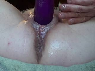 I made a sex swing out of an old camp chair and some rope so I could get just the right camera angle, then fucked her plump blonde pussy with 10 inches of a 12 inch dildo nice and slow and deep until she begged me to fuck her with it fast. then she squirt