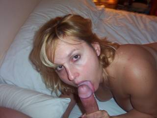 What an Awesome pic! Love her eyes! She definitely knows how to suck a cock! I would Love to blow a load all over her face!