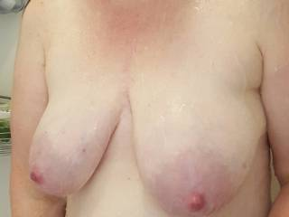 Big heavy milk filled tits in the shower