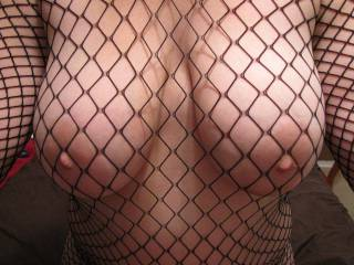 Mmmmm lovin those big  boobs in those fishnets.  I just love lingerie on a beautiful thick gal such as yourself.  Made my night.. thx for sharing hope to see more soon.