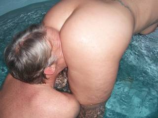 Our swinger friend eats out my pussy in the spa at home, when he came around for a threesome.