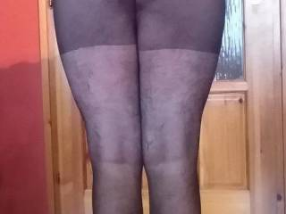 In black stockings and white socks, I show my shapely ass and legs! Like?