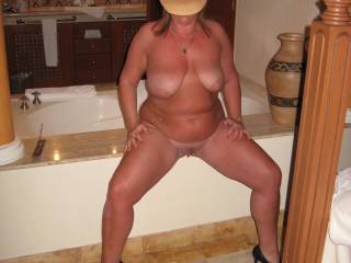 nice hat but your GORGEOUS!!!  love to be on my knees in front of you tasting your pussy while that was taken!!