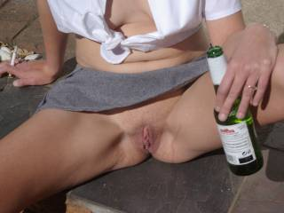 Rub the cool beer bottle over your hot pussy and feel the contrast in temperature, close your eyes and enjoy the sensation.