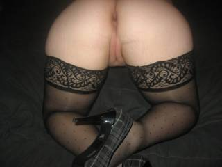 spread that ass and sink my cock balls deep in both her horny holes while your man watches me shoot a load all over your amazing asshole,hows that sound?