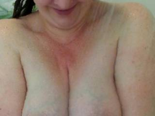 Gazing down at her ample cleavage, imagining your cock buried in there.