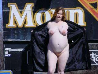 Here is an older shot of my wife when she was pregnant and still flashing.  This one was taken at the top of the mountain infront of the sign of out local ski resort about 5 feet from the road.