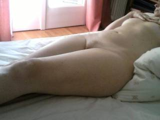 On bed waiting for me to lay beside her......