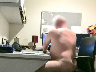 Picture taken at my supervisor's desk. She came in just after I finished getting dressed. I don't know why she came in early. If she ever catches me doing anything like this, I hope she lets me off with a spanking and stern talking to. What do you thi