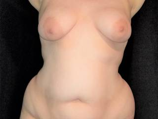 My wife showing off her big titties and wide curvy hips and thighs. Who\'d like to get their hands on her soft chubby body?