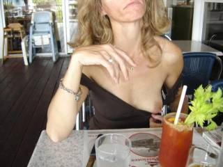 oooh, how sexy!  a suck on the nipple, then on that bloody mary... nice day out!  mmmm