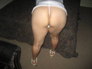 Do you really need to ask???  Great ass and stems.  Sure i'd love to fuck her.  I'd love to oil those legs up and play with them.  looking so good!!!