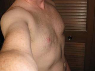 A selfie of my chest where I love seeing cum dripping down