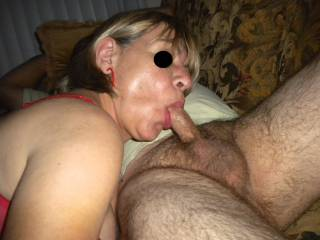 Closer photo of my hotwife sucking this guy's cock! Right after I took this shot this guy mounted my wife and fucked her pussy until he came inside her! What do you think I was doing?