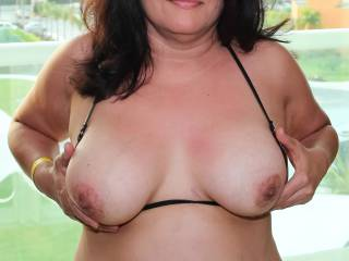Photo 2 of 2: Mexico beach vacation...Tiny bikini top pulled to the side to expose my tits and nipples!
