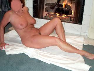 I'm thinking with that smoking hot body, she is warming up the fireplace! :)