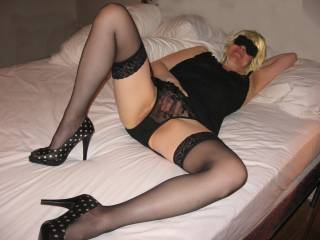 Looking very sexy with black lingerie! Looking at this pic makes my cock rock hard! Let me replace your finger with my hard cock!