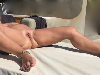 Tanning waxed pussy under the sun