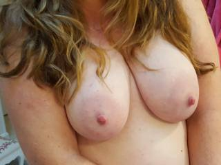 Hubby loves how my hair cascades down my big milk filled tits... what do you think?