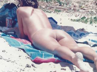 Sarah on the beach.  She loves men ogling her and finds it erotic that men look at her on the beach.  She loves the idea that they want to fuck her.  Would you fuck her?