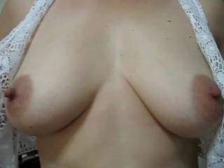 I unbutton my little lace top to reveal my horny tits!