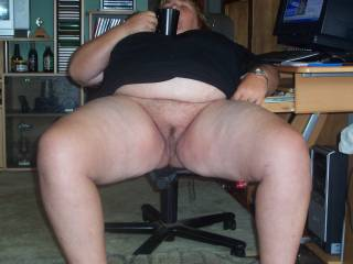 FUCK! … love this pic. This is the way I like to see a woman sit at her computer desk. Love her awesome thick curvy thighs & would love to grope them while I tongue fuck her for hours before then putting my cock in & fucking her balls deep.