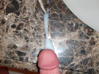 Weekend getaway at a luxury resort.  Hubby jacking off his cock and spraying his cum on the bathroom sink while I watch and masturbate in the bathtub!  I love when he puts on a show for me!