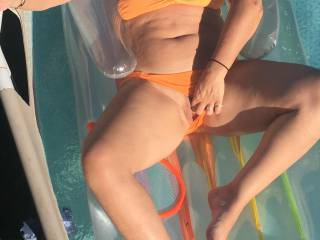 It is wonderful when the sun gets hot and I can float in my pool...stroking my wet pussy...The heat always makes me so hot....want to come for a swim?