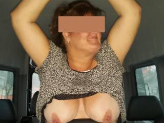 She flashed her tits, he almost crashed! He pulled over in a vacant parking lot, she sucked his cock and let him cum on her big tits for his tip. She came home with his cum on huge tits and nipples.