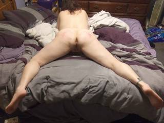 Kitten after having ass paddled hard in a BDSM session, then told to display herself in a ready-to-fuck position