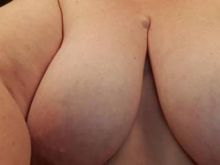 Love these nice big titties, who else would love to play with them and lick and suck her nipples?