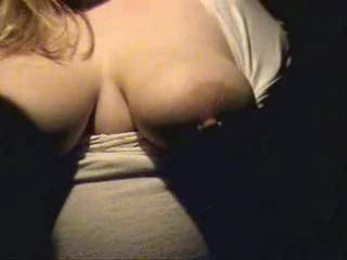 An artistic video shot from light to dark shadows creating a certain element of intrigue. Nice looking California blonde, pregnant, showing off, getting groped like good friends that can\'t resist. Good close-ups of big tits, nice large areola. Enjoy and w