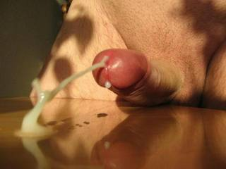 That's one of the best cum shots ever!  And it's very obvious that it's a thik and sticky cum.  NICE!