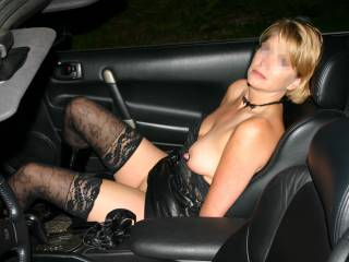 Her hands are cuffed behind her back. Skirt pulled up and top pulled down. This wasn\'t taken there but we went through a Taco Bell drive-thru about 1 am with her like this. @couplelooking