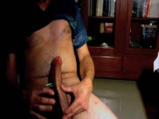 Stroking my huge cock on a chair