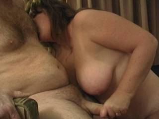 My wife licking my nipple while giving me a handjob