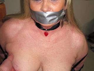 duct taped and getting a tit squeezed She loves it