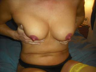 She has quite small breasts but nice thick nipples which she put lipstick on to show them off more. Rude girl