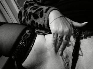 Showing off her pussy in black and white.