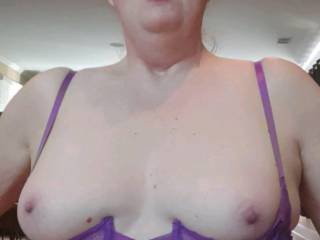 She is riding cock and he films her tits and facial expression.