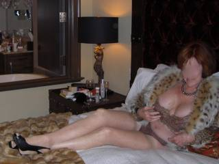 Wife in hotel wishing she had some stranger to play with .
