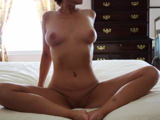 Nice shot, I like taking pictures, can I shoot some of her?  Nice tits sweetie, and you have  hot body too..ummm good. I bet you are finger lick'n good as well. :o  (g)