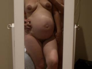 full term, and just hours away from having bubs. hubby couldn\'t help but want some more sexy pics of my big pregnant belly.