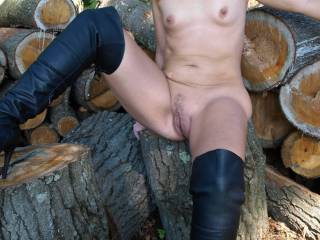Hubby caught me dressing like a naughty girl and made me go to the woodpile. He said I needed to be taught a lesson and made me take the dress off. After giving me a good lickin\',  he took out a big stick and thrust it upon me.  Now, did I deserve that?