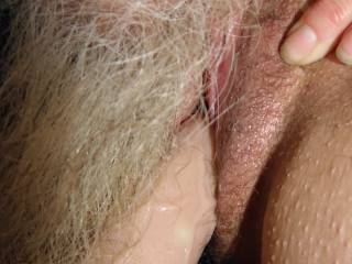 licking her clit as she fucks her hole