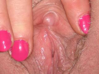 That little pearl needs my tongue's loving.  What a pleasure it would be to suck it to orgasm.