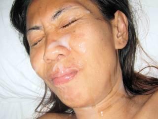 Lek, skinny Thai hottie gets my full load over her face....