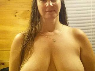 I'd love to be sucking on your gorgeous tits while you were sitting on my lap, my throbbing hard cock deep inside of your hot, wet pussy....you slowly fucking me until I blew a hot load deep inside of you!